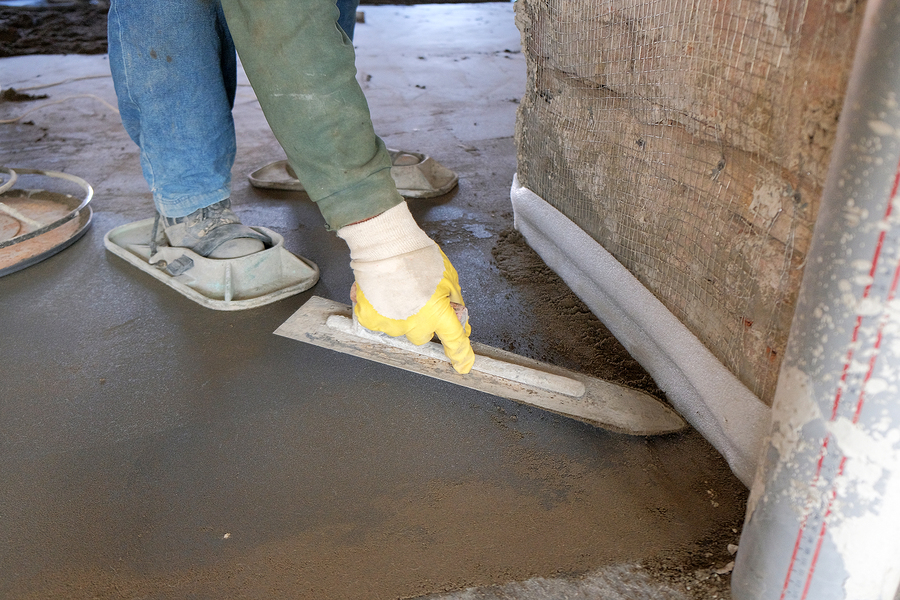 man working stamped concrete