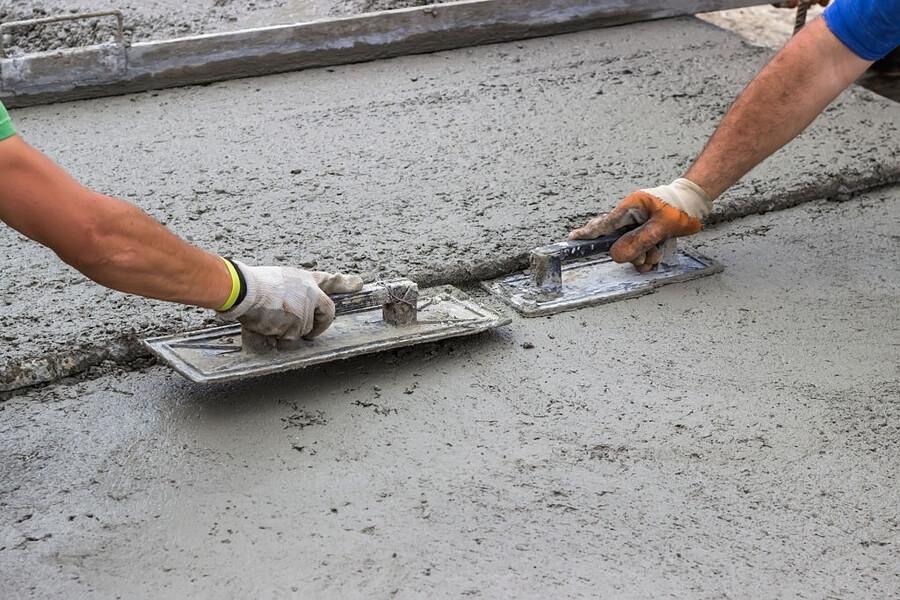 men repairing the crack on the concrete