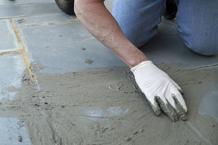 Man stamping the concrete