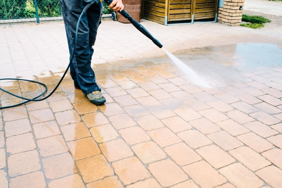 man cleaning the concrete patios