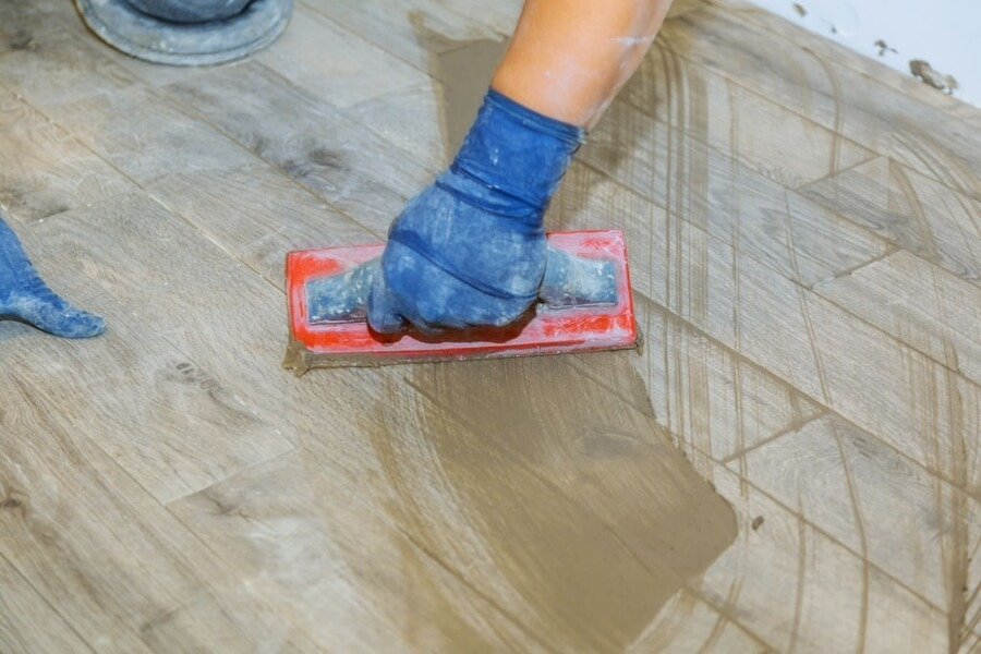 A man with an equipment for stamped concrete