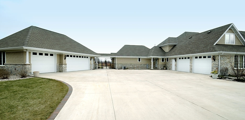 Extra large five stall garage gabled roof with concrete driveway